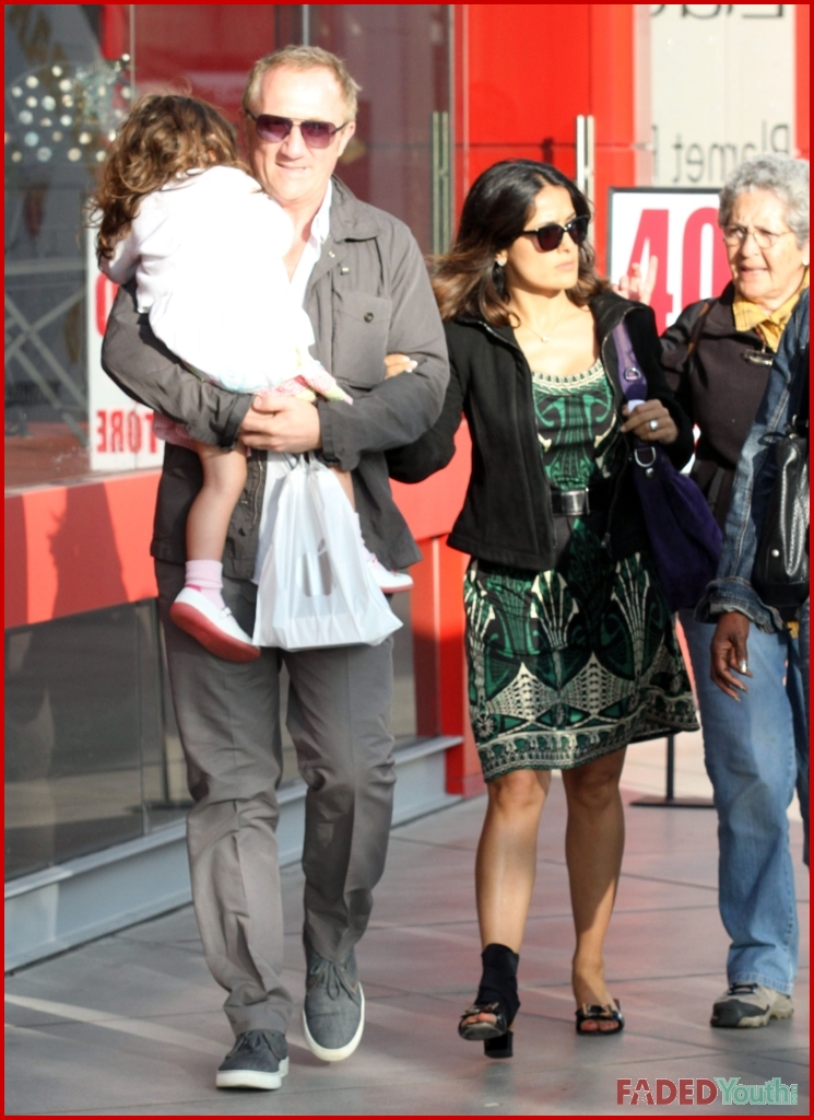 Salma hayek enjoys a day out with her family despite foot injury