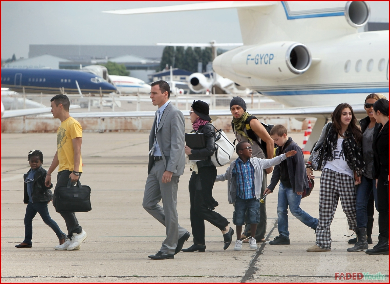 Madonna And Her Kids Fly By Private Jet Faded Youth Blog