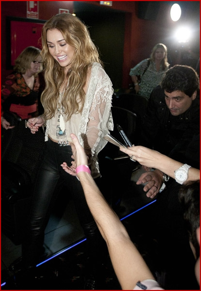 Miley cyrus tight leather pants meet and greet in madrid plus emily osment sits up tall as she signs copies of her debut album fight or flight at el corte ingls castellana in madrid spain on thursday afternoon m4hsunfo