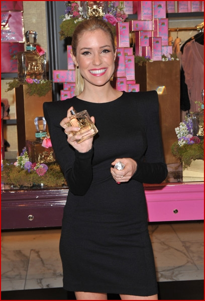 all smiles as she hosted the Peace Love & Juicy Couture fragrance launch